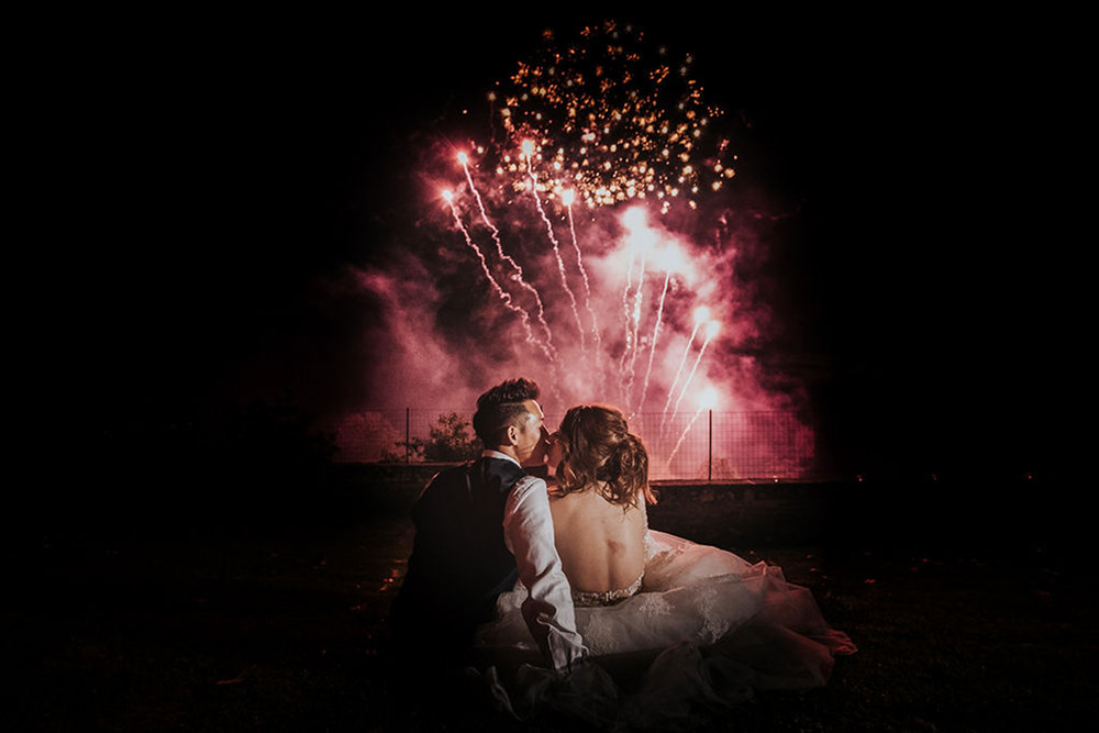 Wedding Couple Kiss With Fireworks - Château du Doux